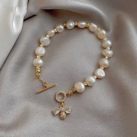 Bracelet en perle naturelleavec abeille Zircon